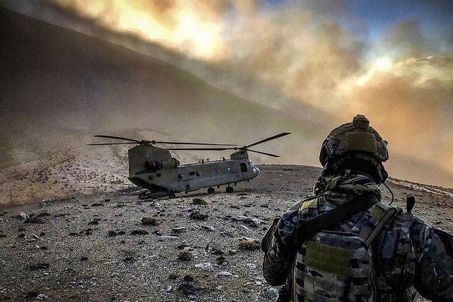 An airman observes a US Army An airman observes a US Army helicopter at an undisclosed location in Afghanistan, February 9, 2018. (Photo: The US Army)helicopter